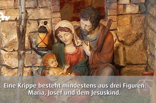 Geschnitzte Krippenfiguren von Josef, Maria und dem Jesuskind.