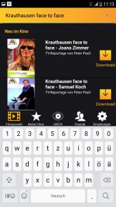 """Über das Suchfeld der App kann nach unterstützten Filmen gesucht werden. Durch """"Antippen"""" von Download wird für den gewünschten Film die Audiodiskription heruntergeladen."""