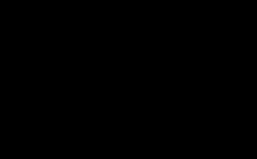 Schwarze, wilde Tinetntropfen auf einem weißen Papier